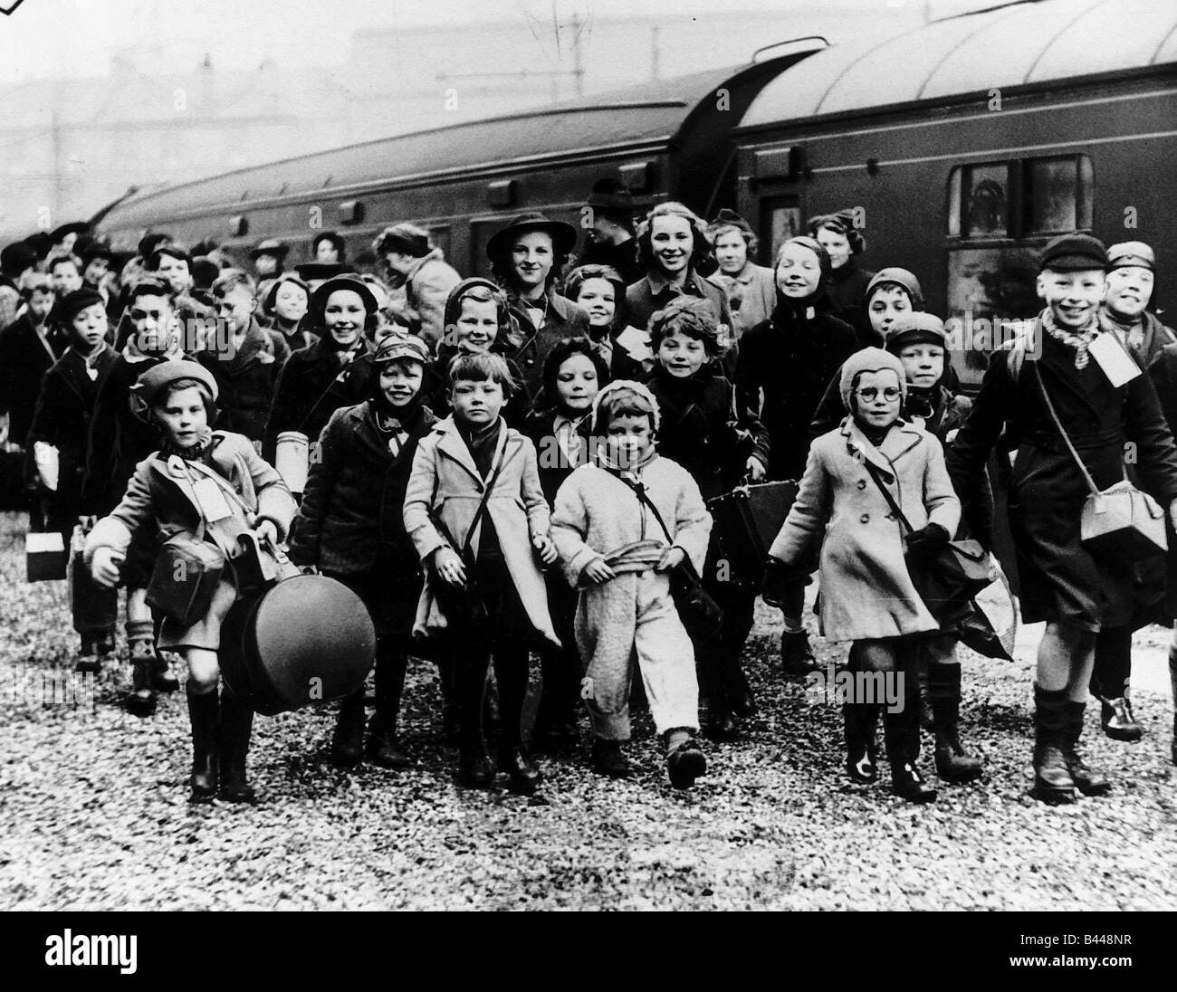 World War Two Children evacuated from the cities disembark from a train in the West of Scotland - Stock Image
