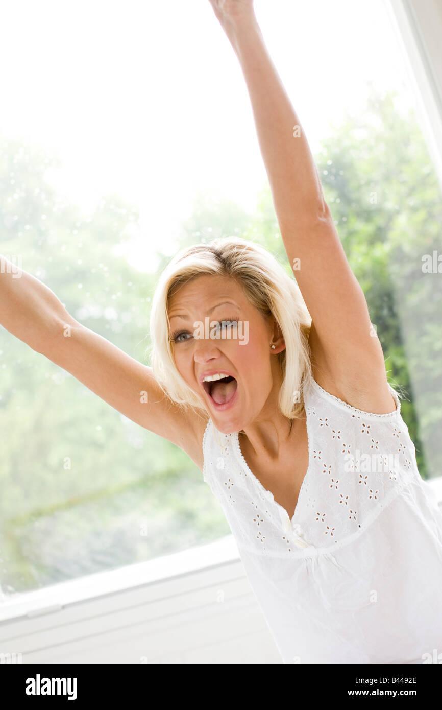 Woman celebrating - Stock Image