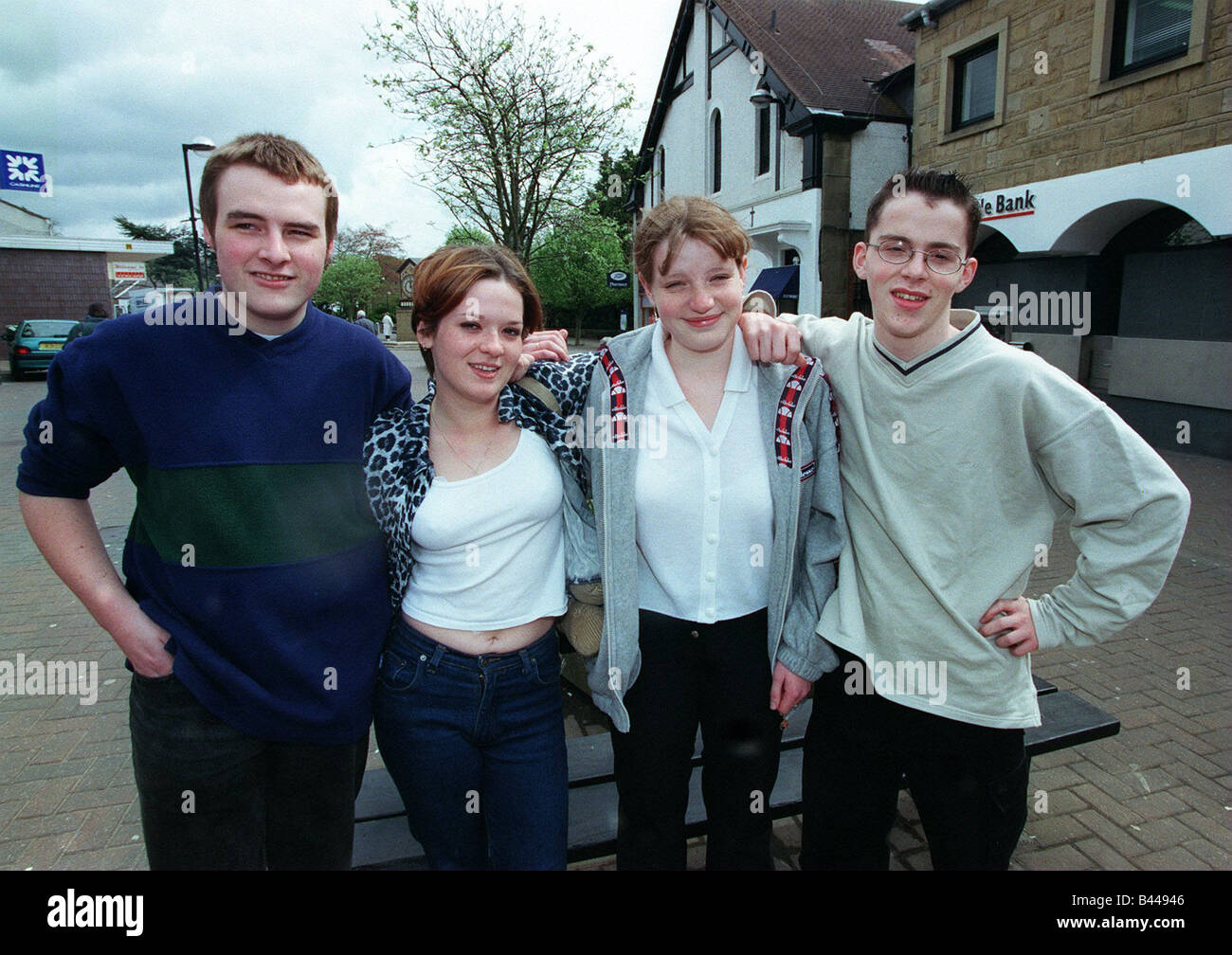 Gang warfare Milngavie and Bearsden May 1998 group teenage girls boys in town centre - Stock Image