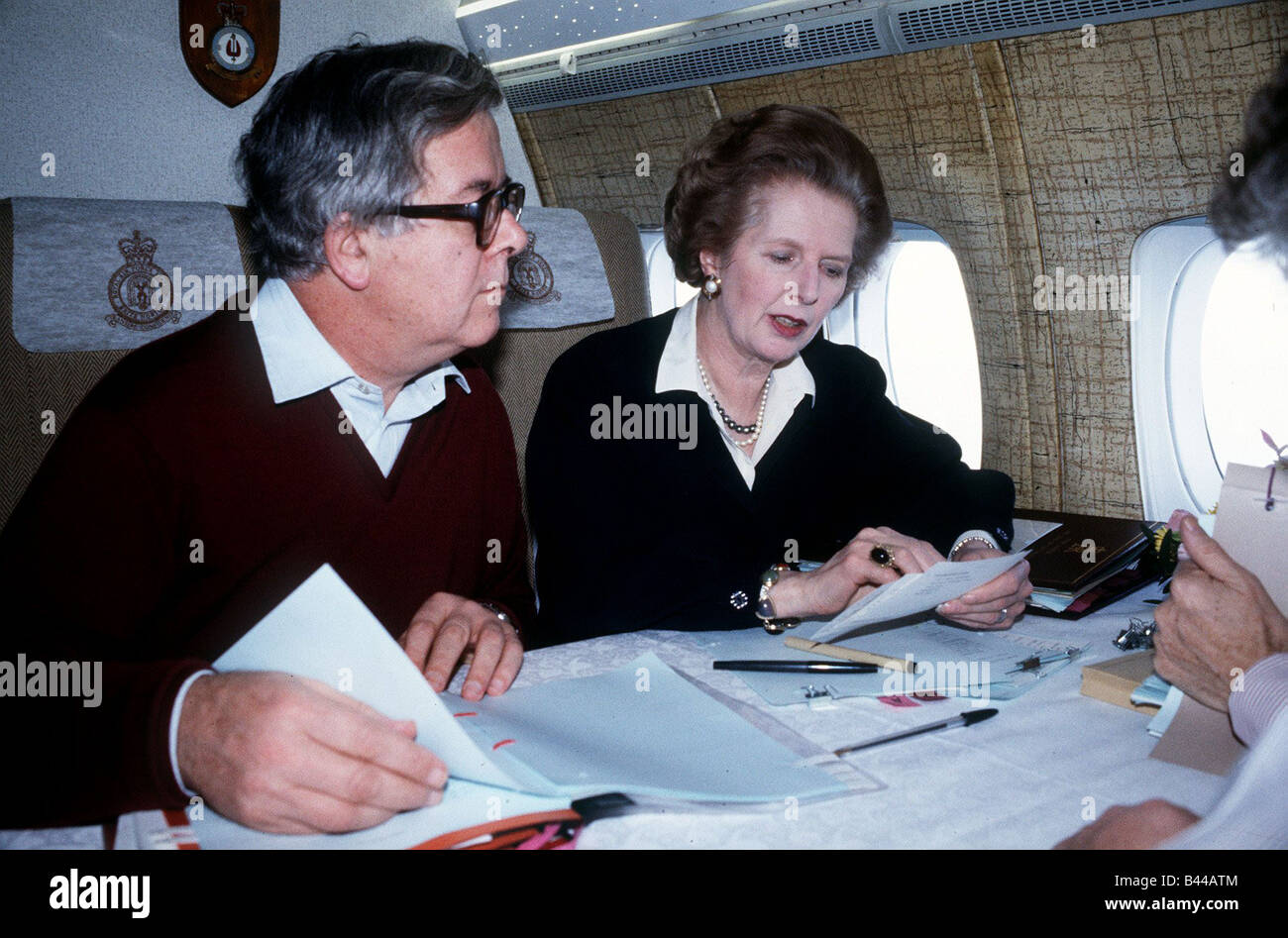 Margaret Thatcher MP prime Minister with Geoffrey Howe MP sit on a plane on their way to China to sign Hong Kong - Stock Image