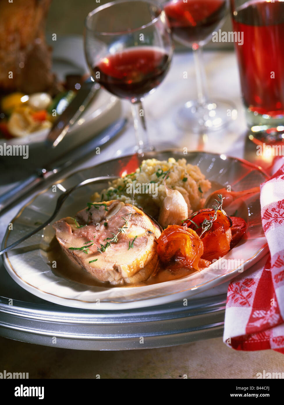 Lamb's leg studded with almonds and traditional mashed potatoes - Stock Image