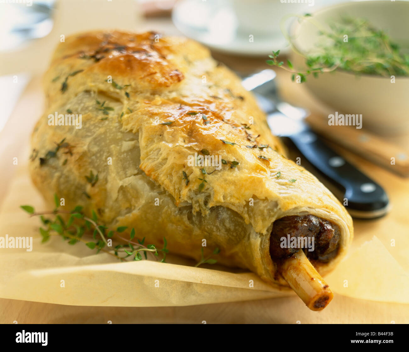 Leg of lamb in flaky anchovy crust - Stock Image