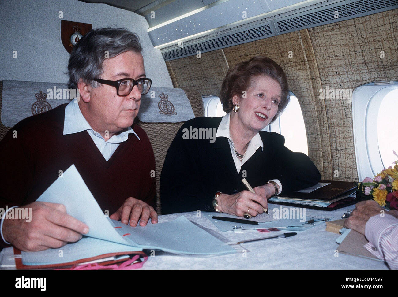 Margaret Thatcher Prime Minister with Geoffrey Howe MP on their way to China 1984 - Stock Image