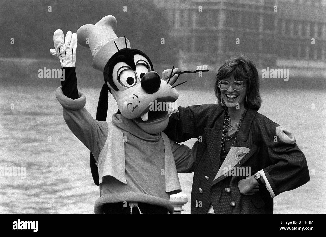 Janet Street Porter with Goofy on River Thames 1983 - Stock Image