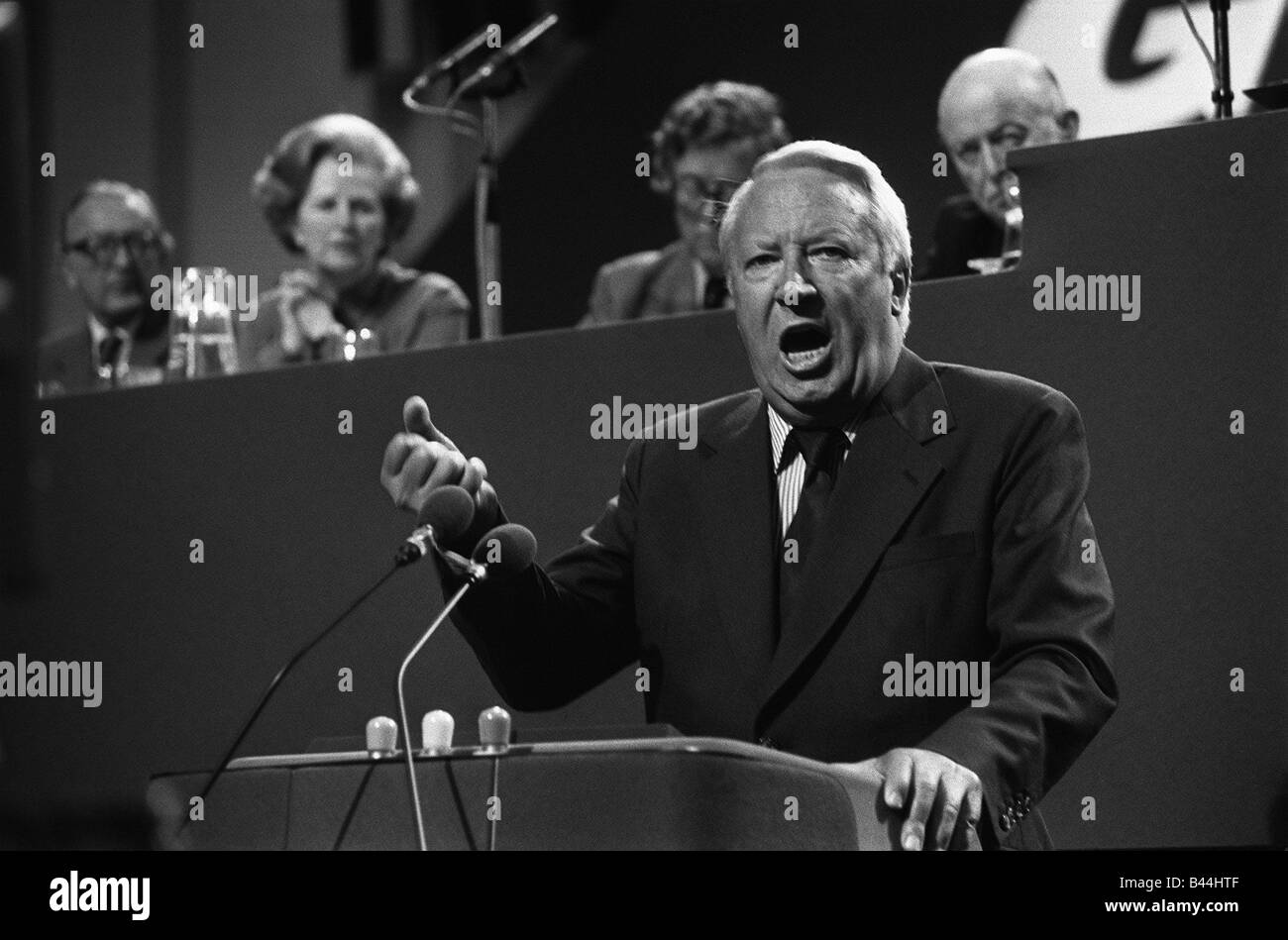 Edward Heath speaks at Conservative conference 1978 with Margaret Thatcher and Geoffrey Howe sitting on podium - Stock Image