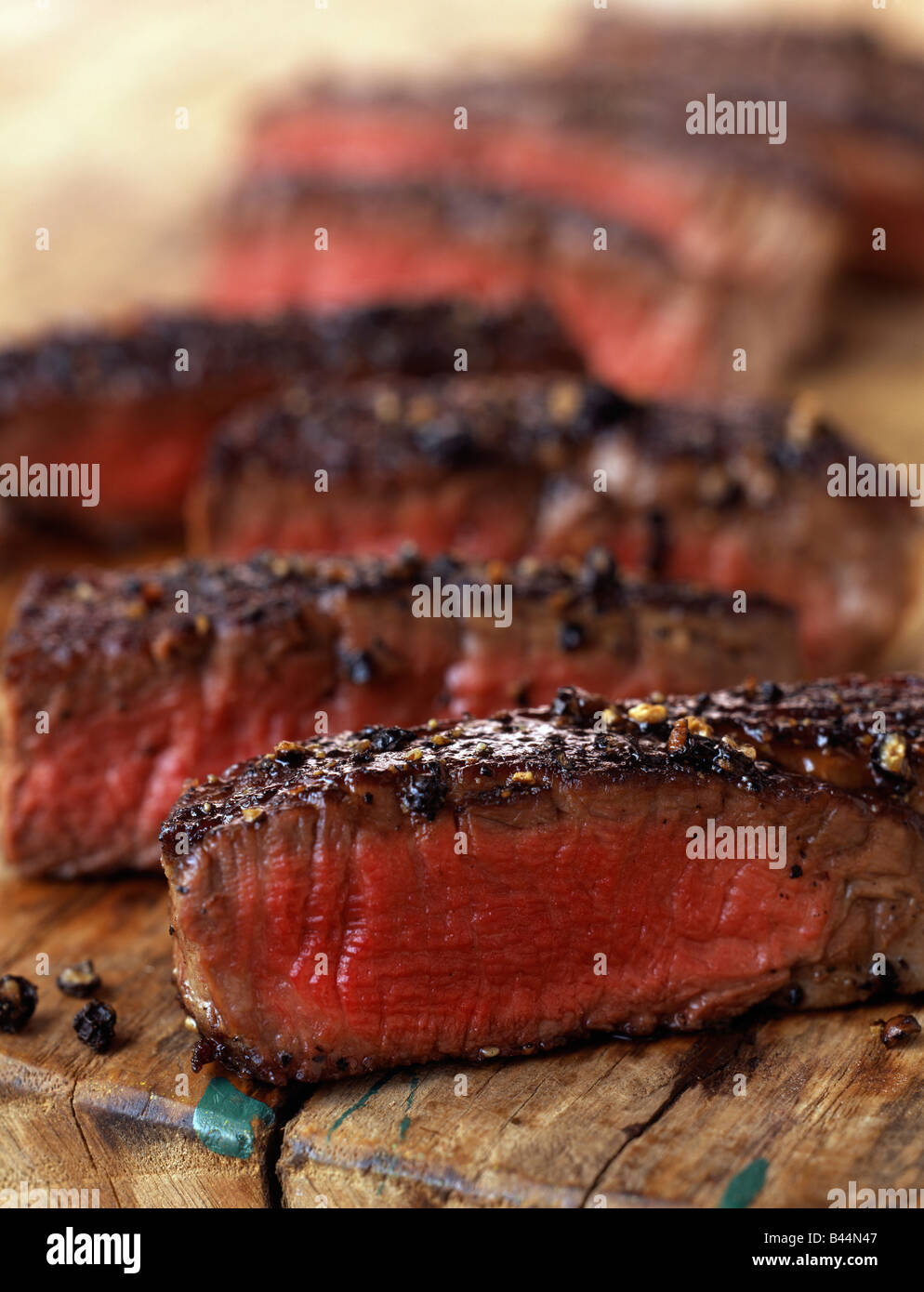 Medium cooked slices of beef fillet with pepper - Stock Image
