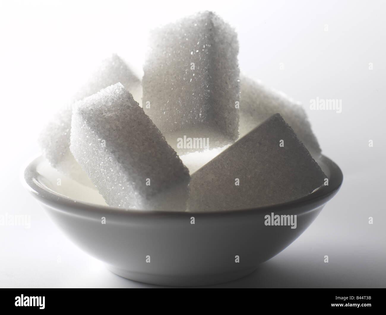 sugar lumps in small dish - Stock Image