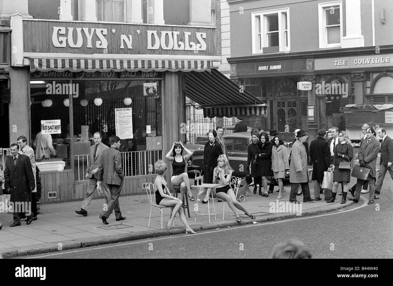Models Wearing Swimsuits Sit Outside Guys And Dolls In The Kings Road Chelsea London