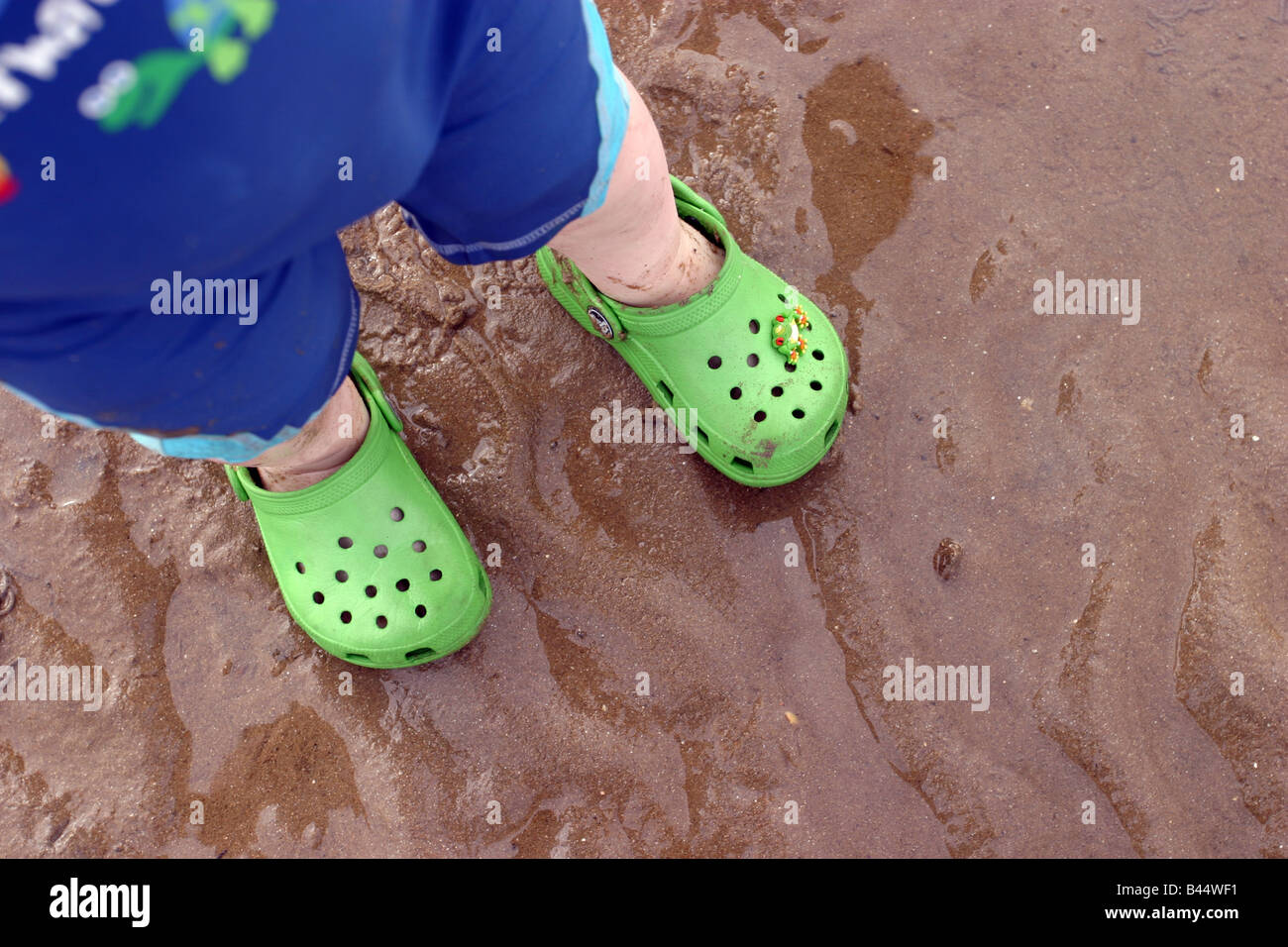 ccb3fb3b2df5 Kid wearing Crocs shoes Stock Photo  19776821 - Alamy