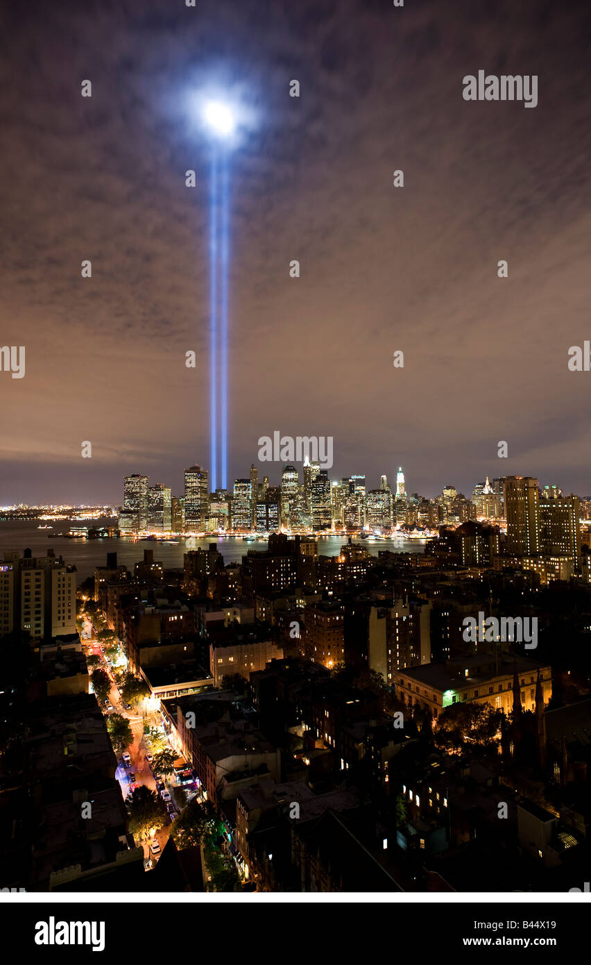 Tribute in Light memorial lights as seen from Brooklyn shining high above Manhattan - Stock Image