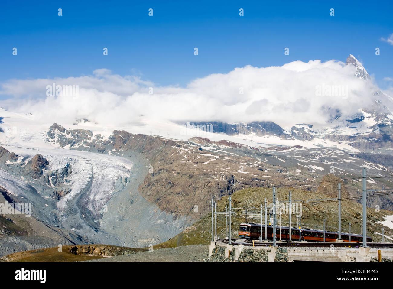 Gornergrat cogwheel Train in front of Matterhorn and glacier - Stock Image