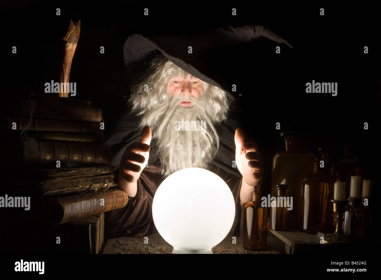 Fortune telling wizard at work at halloween - Stock Image