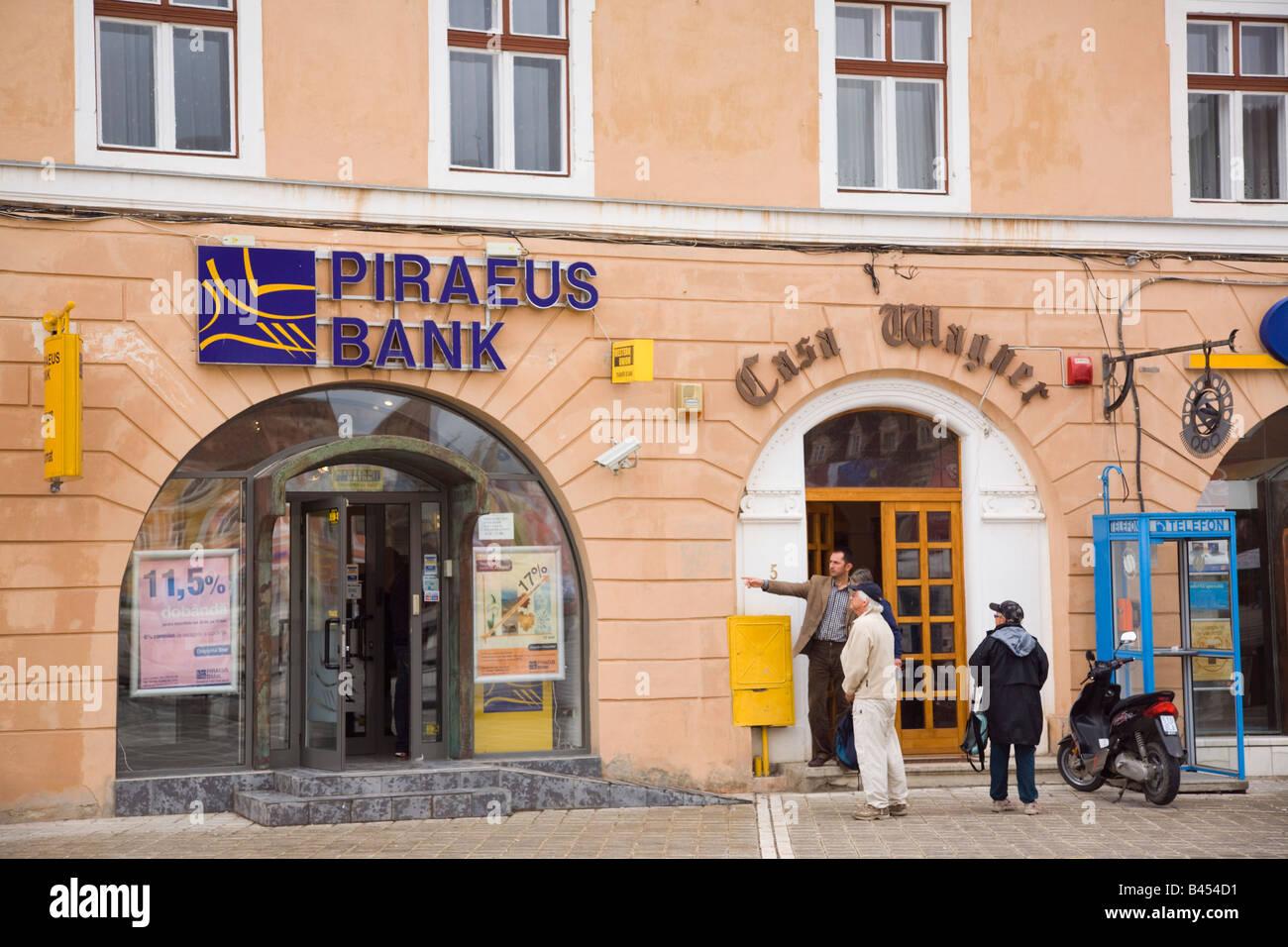 Brasov Transylvania Romania Europe Piraeus Bank retail banking branch building exterior in historic city - Stock Image