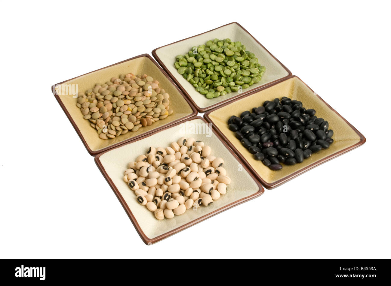 four dishes of lentils, peas, beans, black eyed peas Stock Photo