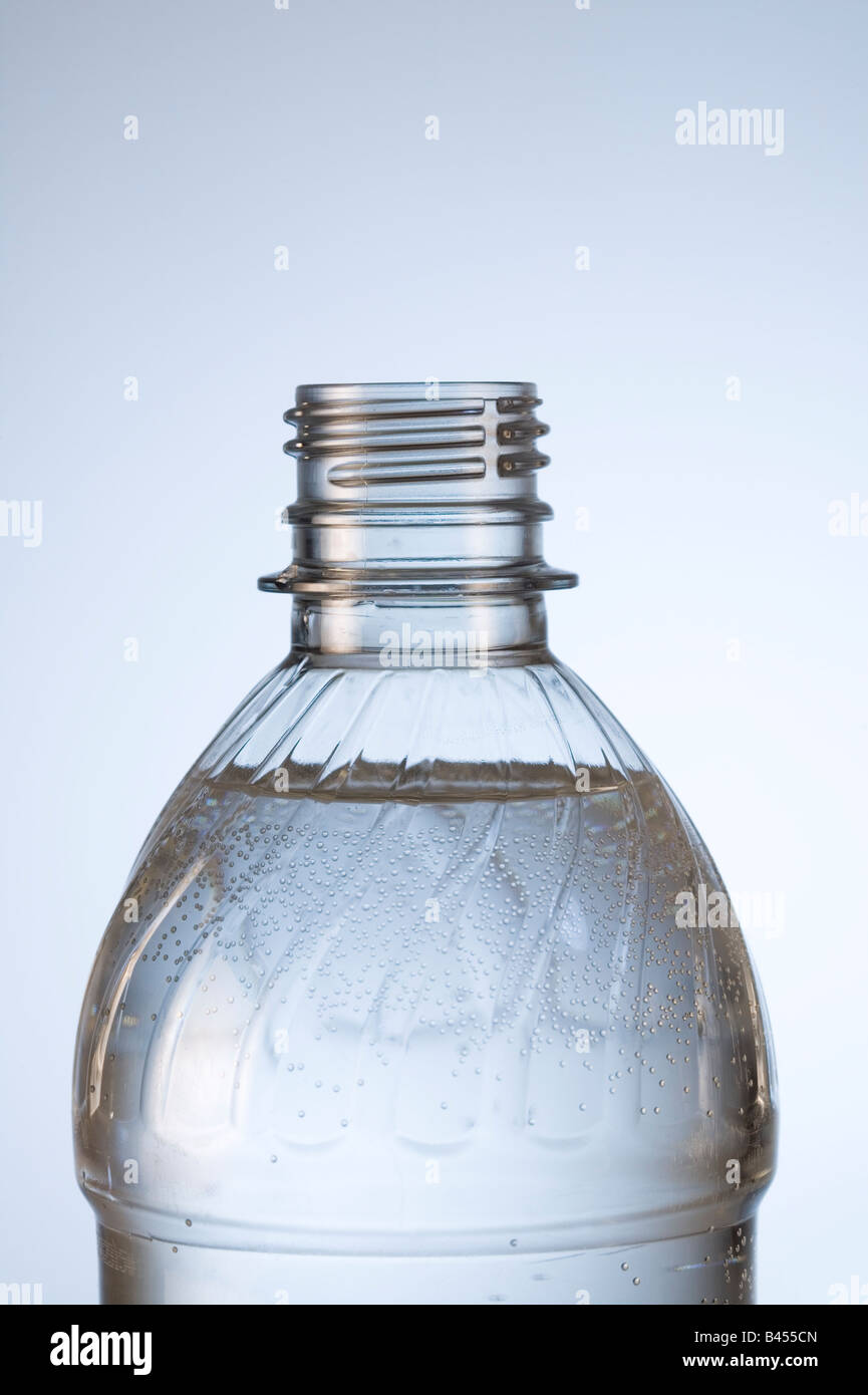 Close-up of plastic water bottle h2o in studio white background vertical. - Stock Image