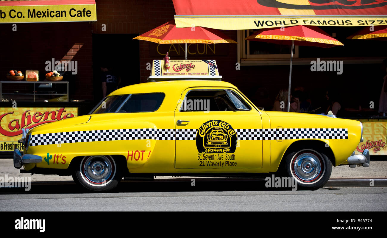 Old taxicab advertising Mexcian restaurant in New York city - Stock Image