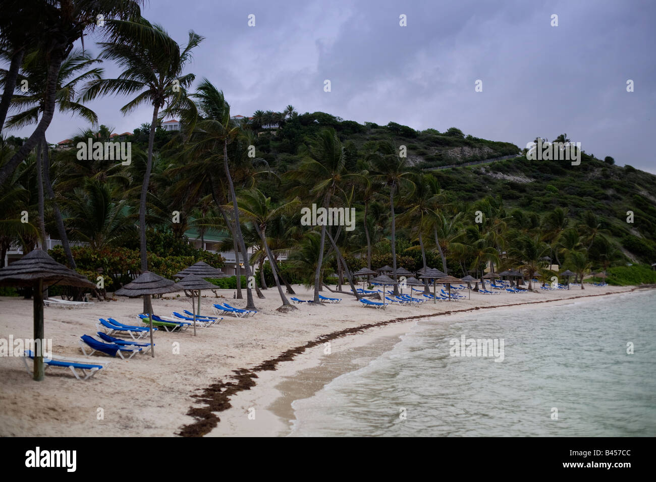 A deserted beach at the St James's Club Hotel on the Carribean island of Antigua as a tropical storm approaches - Stock Image