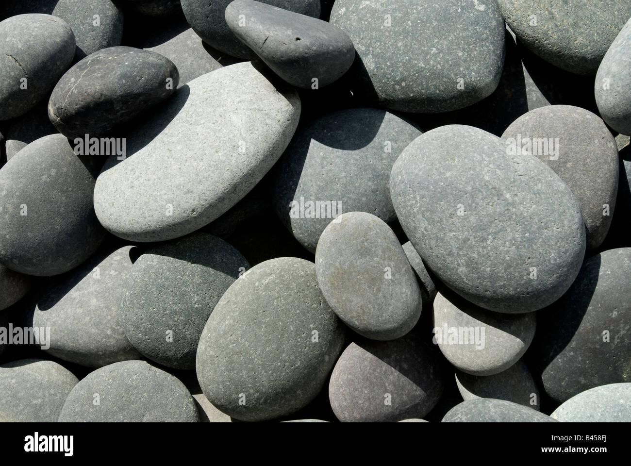 Smooth river stones in pathway of garden walkway, Miami, Florida. - Stock Image