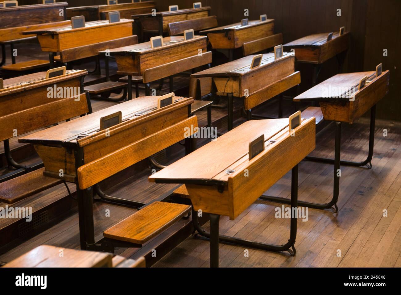 UK Scotland Glasgow Scotland Road School Pre war era schoolroom desks with slates - Stock Image