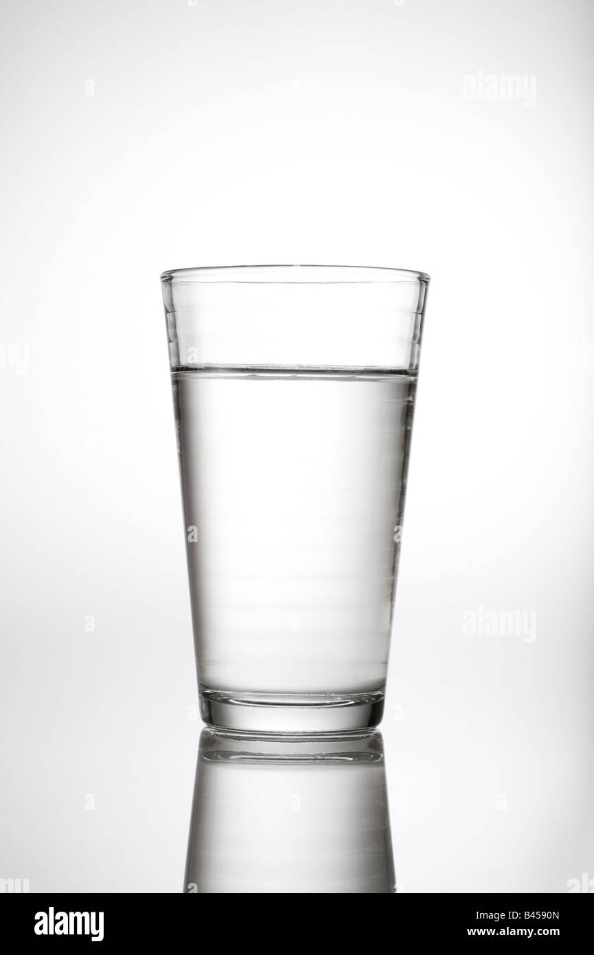 Glass of water h2o in studio white background with reflection. - Stock Image
