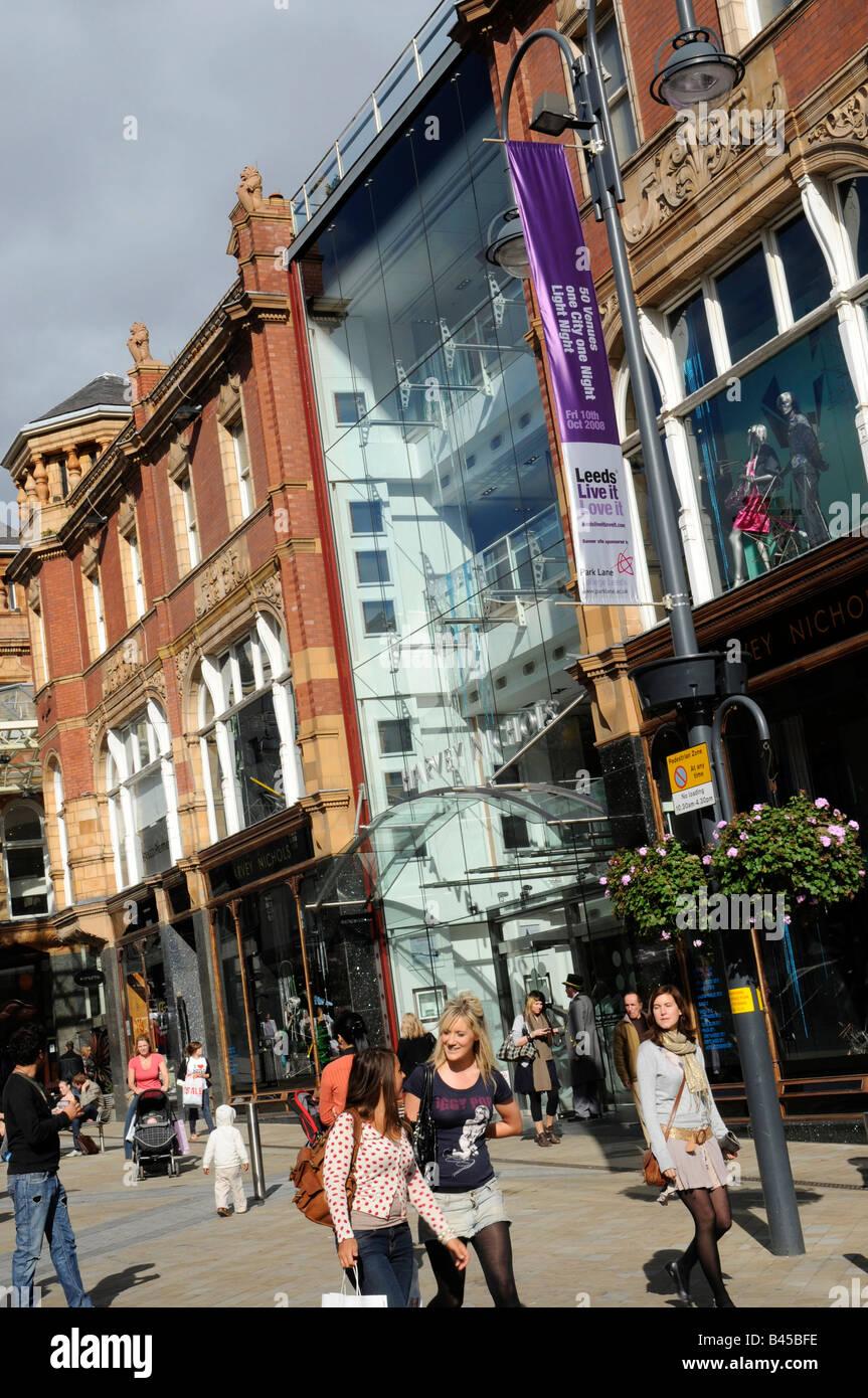 Briggate Leeds, main shopping street, showing Harvey Nichols store - Stock Image