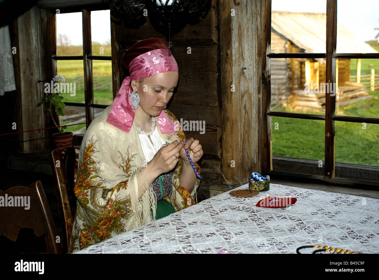 geography / travel, Russia, skilled crafts, young Russian woman stringing pearls, museum village, island Kishi in - Stock Image
