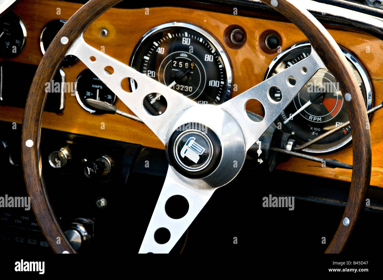 Dash and steering wheel in a Triumph TR 4A car Stock Photo