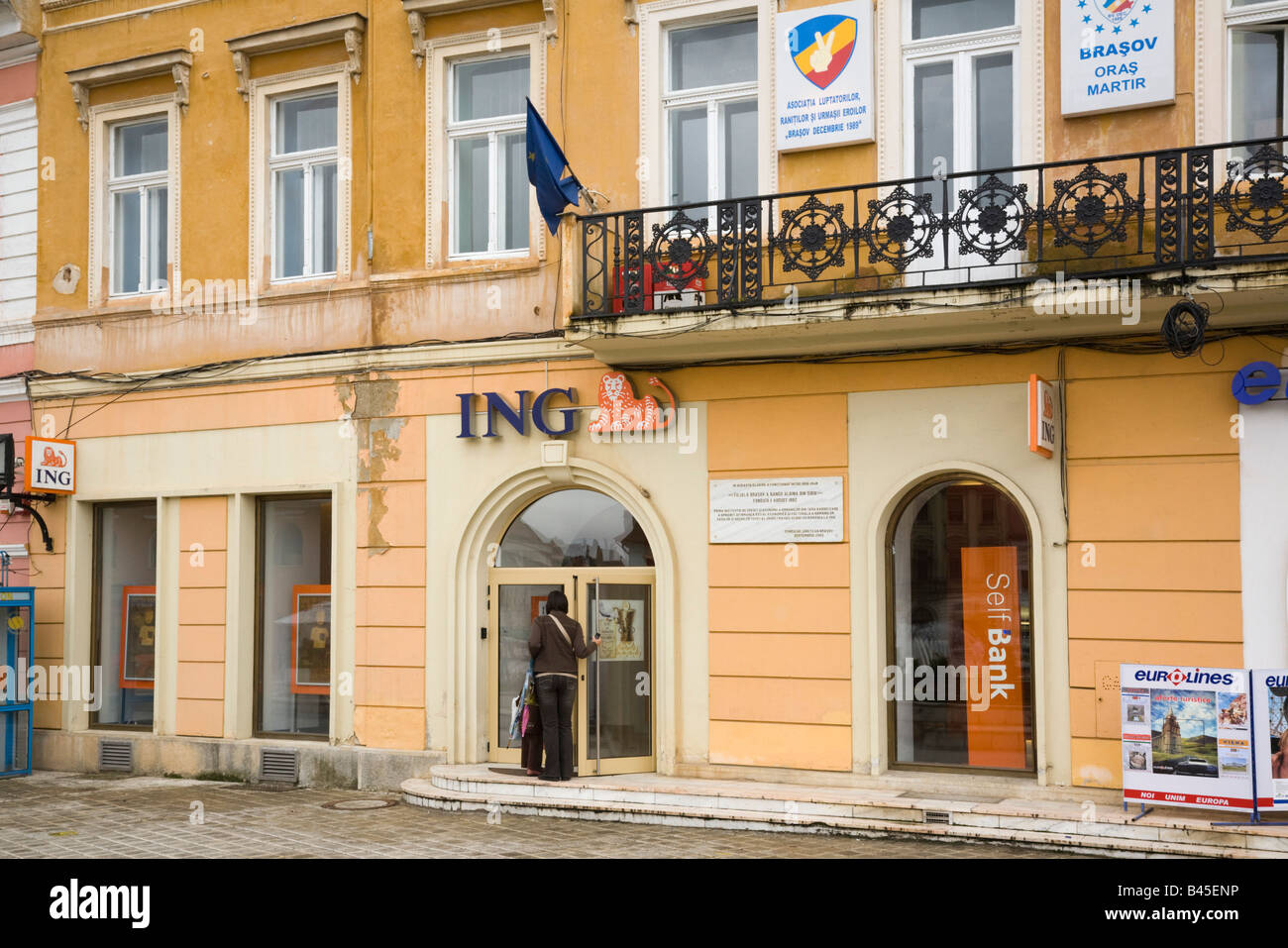 Romania Europe ING Bank retail banking branch building exterior in historic city - Stock Image