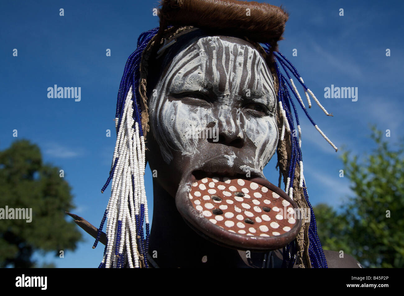 A Mursi woman with lip plate, Mago National Park, Southern Ethiopia, East Africa - Stock Image