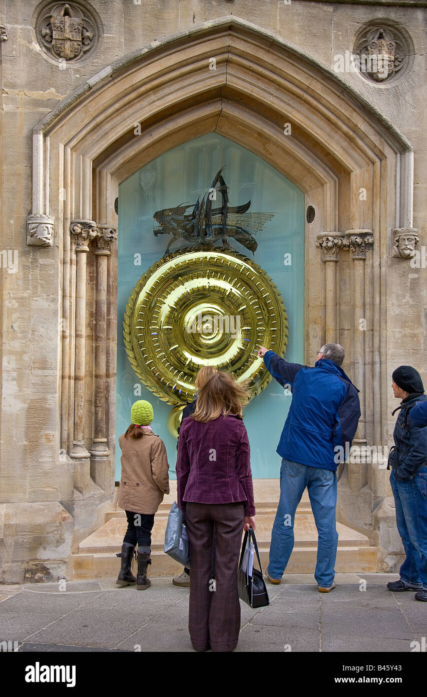 Passers bye discussing the new Corpus Clock, showpiece of Corpus Christi's new library Stock Photo