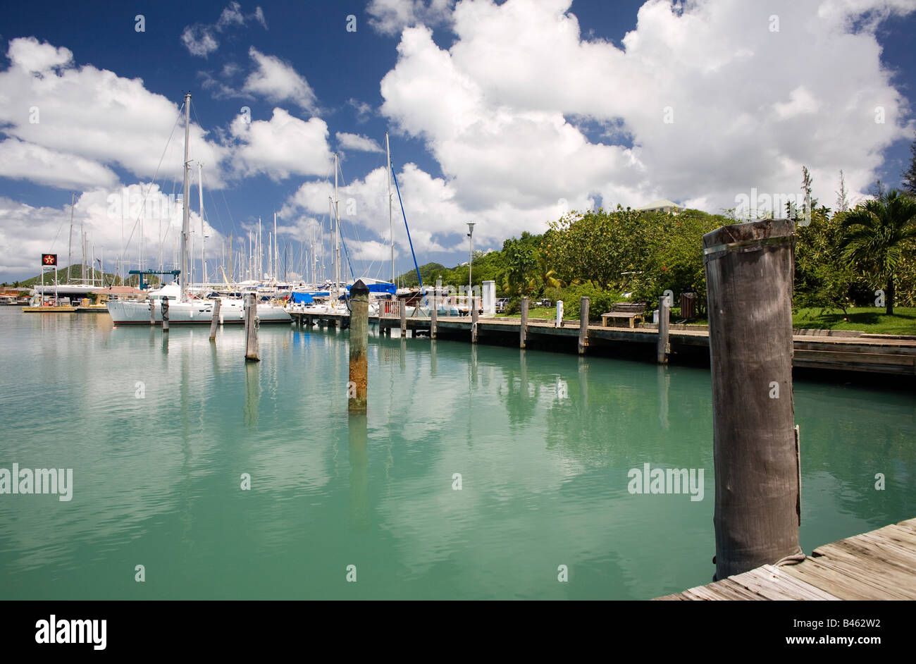 Yacht moored by the Texaco fuel station in Jolly Harbour on the Carribean island of Antigua, West Indies - Stock Image