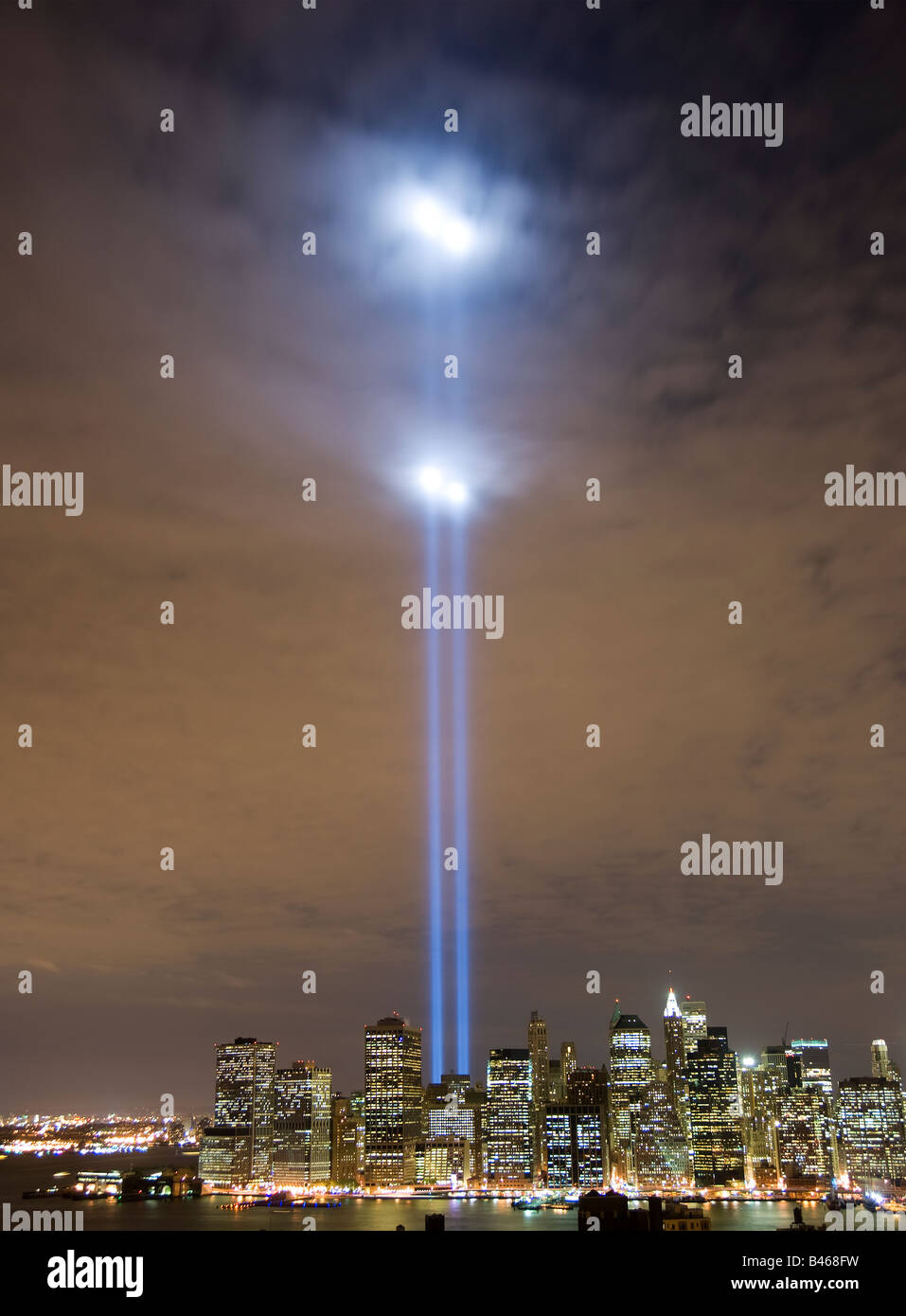 Tribute in Light memorial lights shine high above Manhattan illuminating the clouds Stock Photo