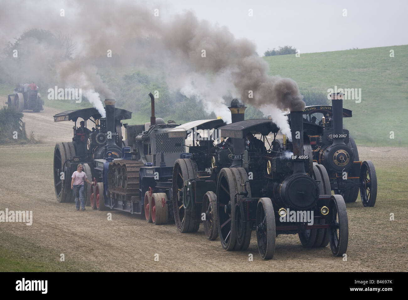 Trio Tandem Steam Traction Engines Haul Bulldozer On Pickford's Trailer - Led By McLaren 8nhp 'King Harry' - Stock Image