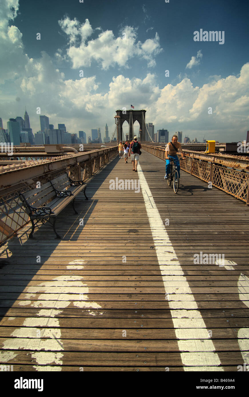 The walkway across the Brooklyn Bridge in New York city has separate lanes for pedestrian walkers and bicyclists. - Stock Image