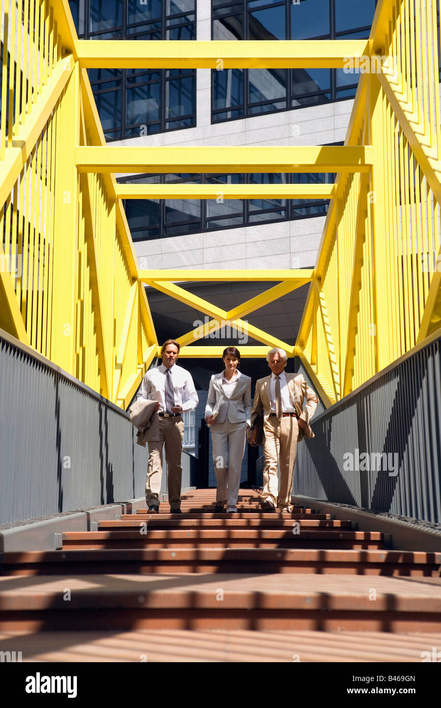Germany, Baden Württemberg, Stuttgart, Business people walking on bridge - Stock Image