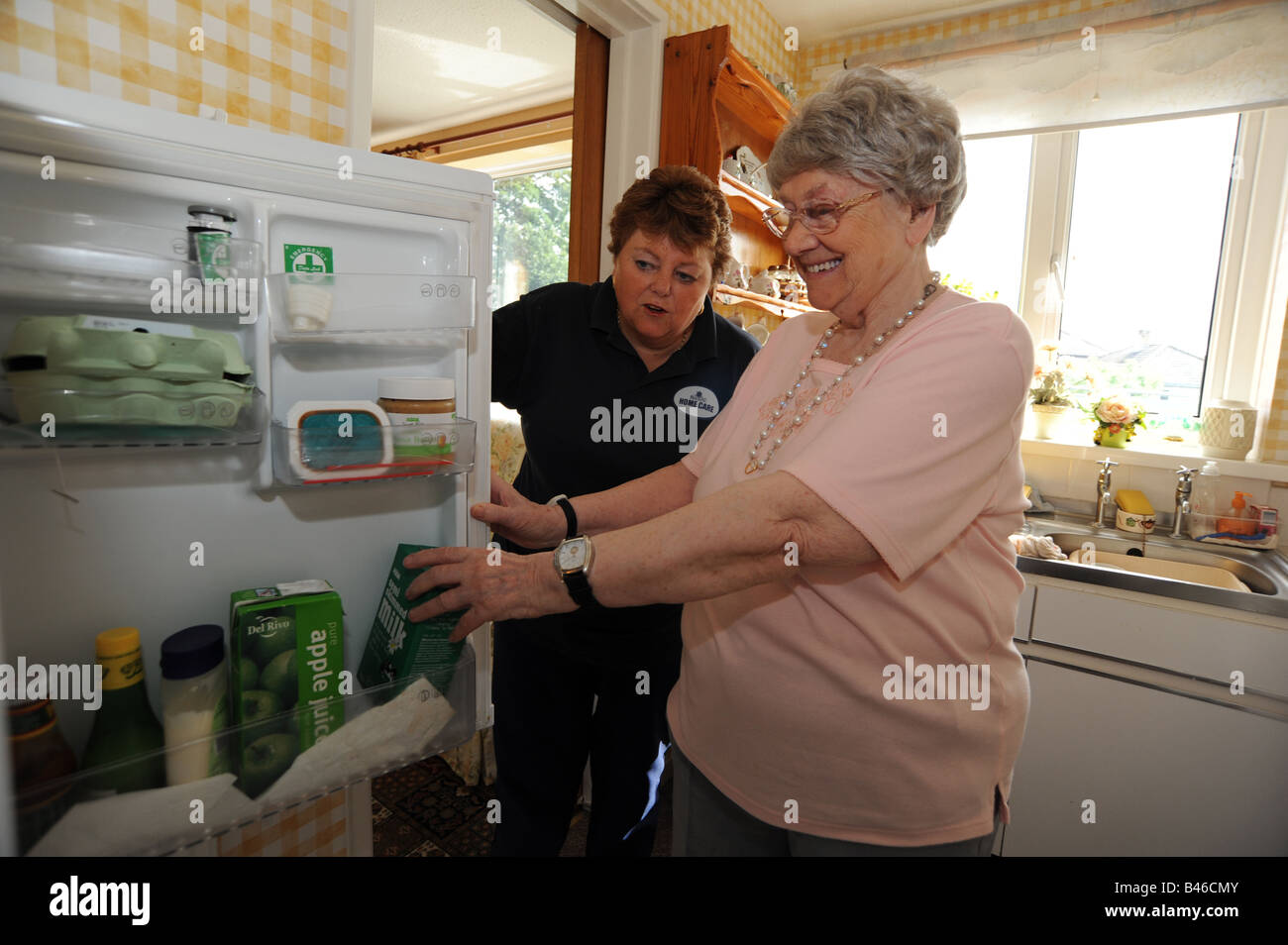 Council Homecare Staff enable elderly and disabled people to live in their own homes through support and help with - Stock Image