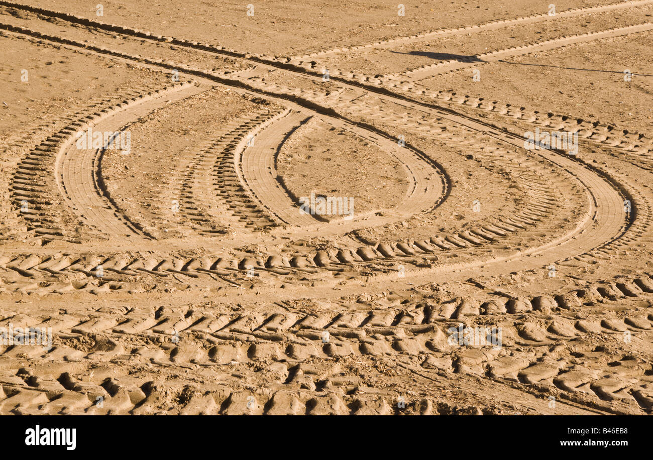 Tire tracks in the sand - Stock Image