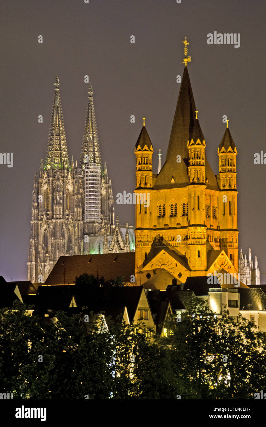 Great St Martin's Church and Cologne Cathedral at night - Stock Image