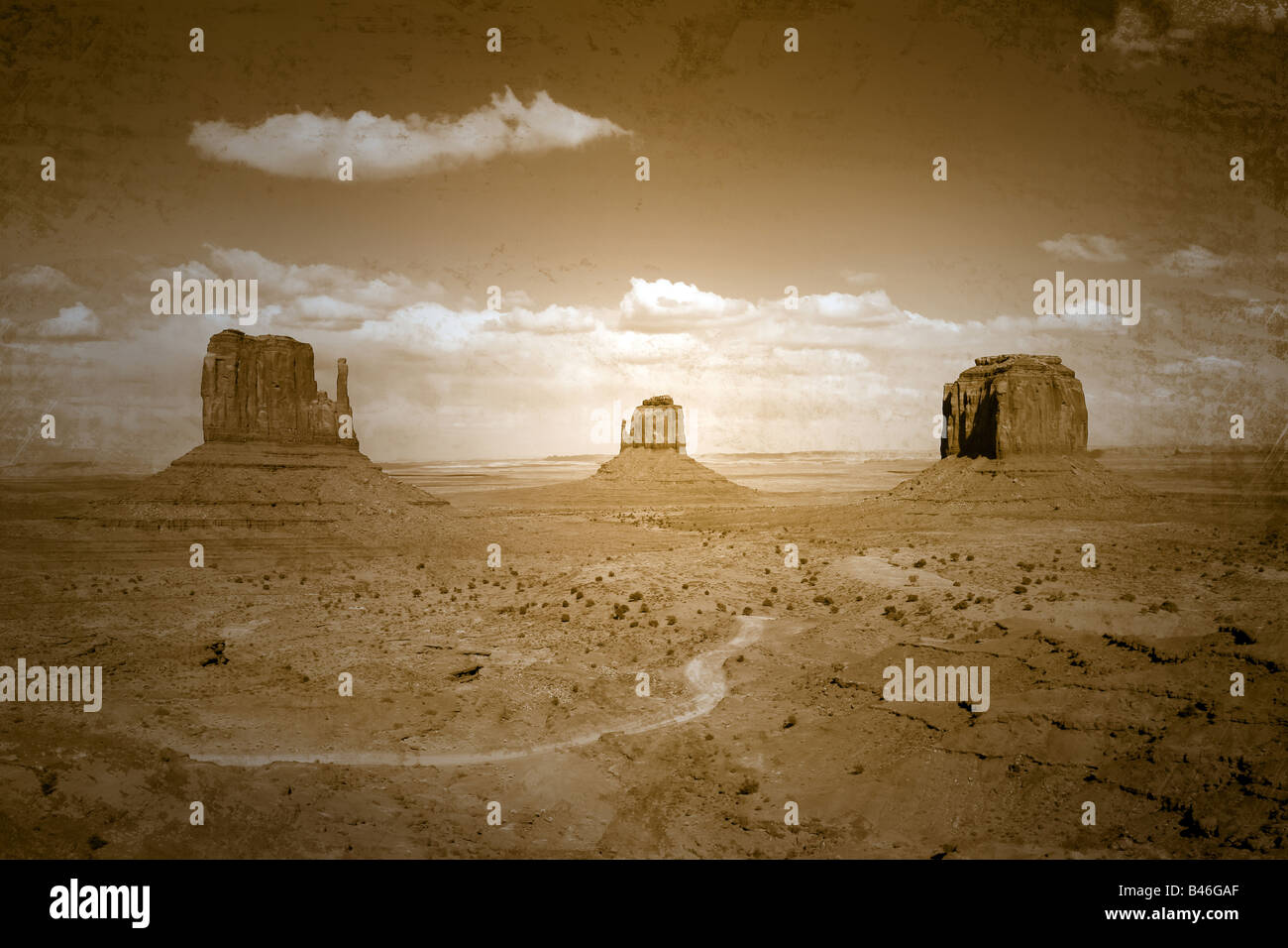 Grunge Tattered Vintage Style Photograph of Monument Valley Landscape Intentional Distressing Applied - Stock Image