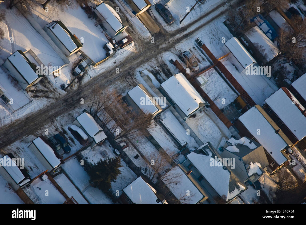 Snow covered houses in residential suburb - Stock Image