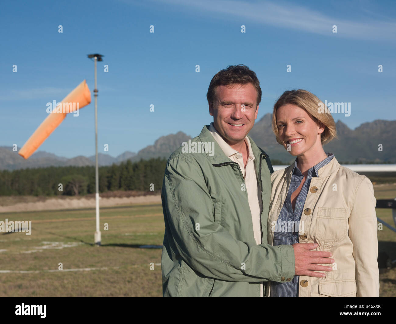 Couple on airfield - Stock Image