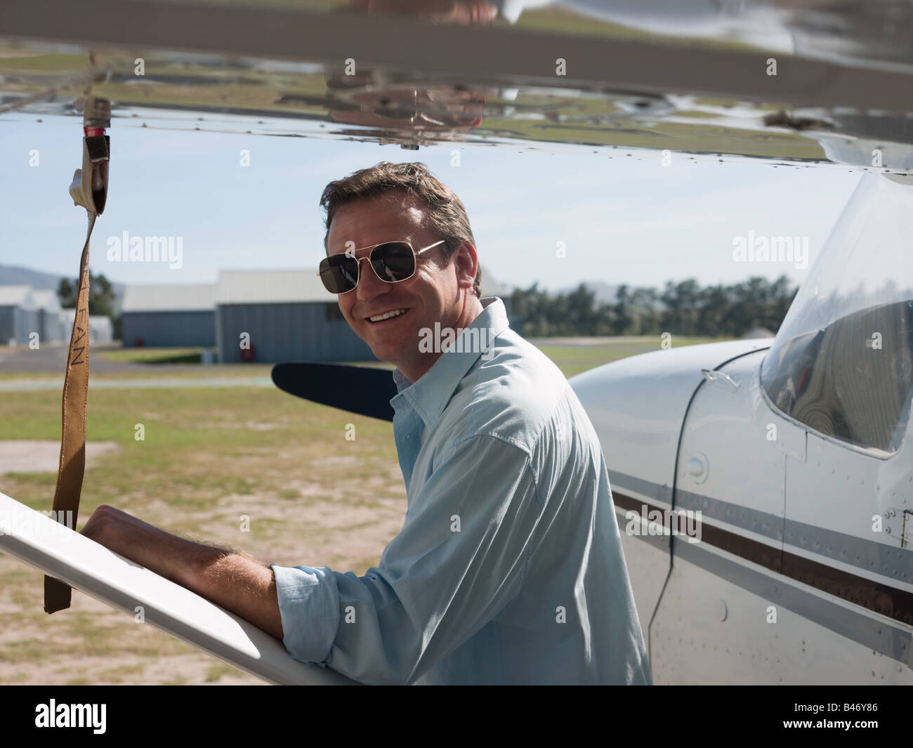Man by private aeroplane - Stock Image