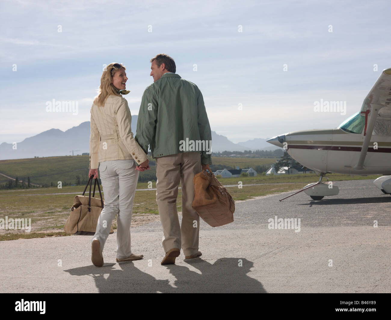 Couple by private aeroplane - Stock Image