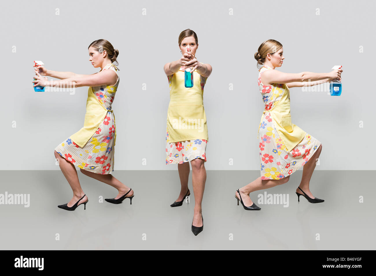 Woman spraying cleaning product Stock Photo
