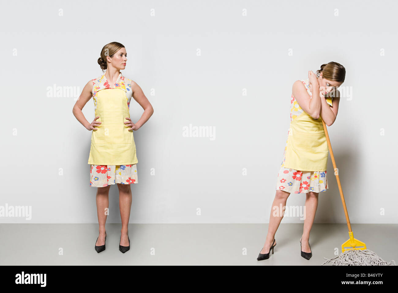 Woman with a mop - Stock Image
