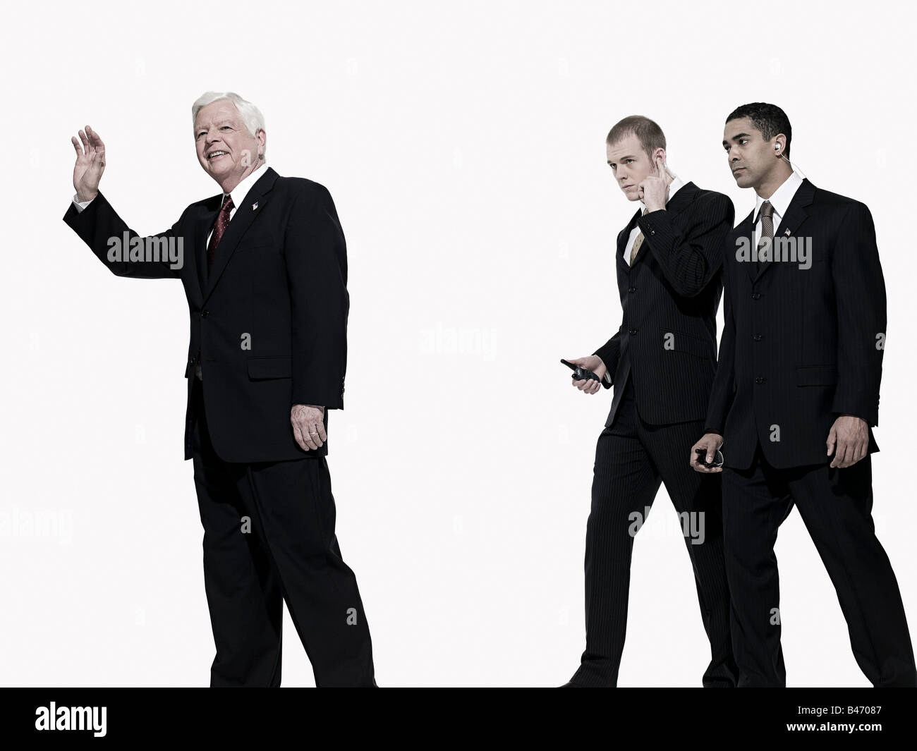 Politician and bodyguards - Stock Image