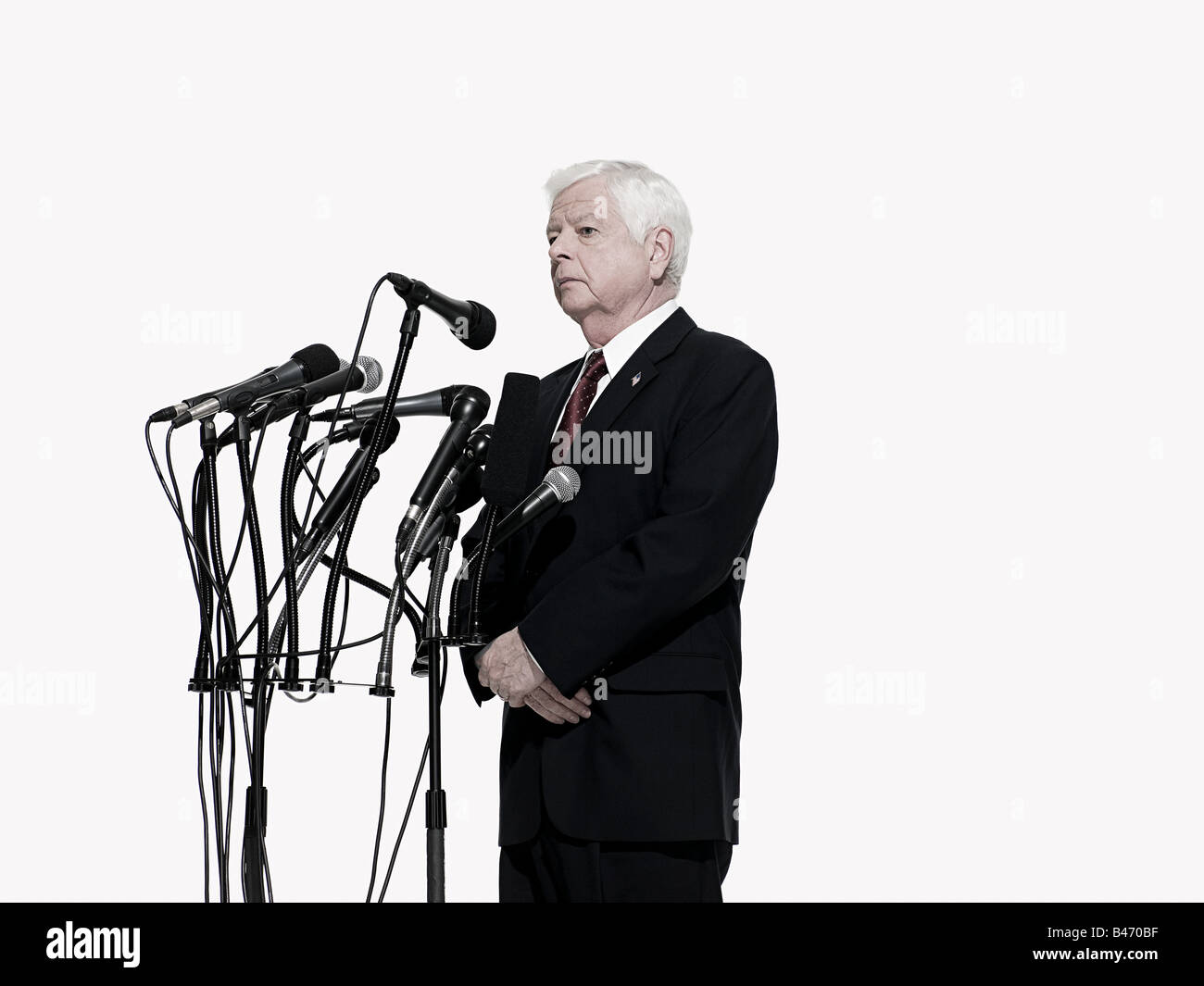 Politician and microphones Stock Photo