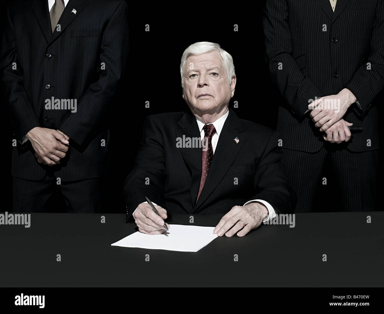Politician signing paper Stock Photo