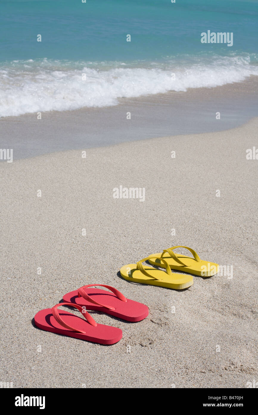 Flip flops on beach - Stock Image