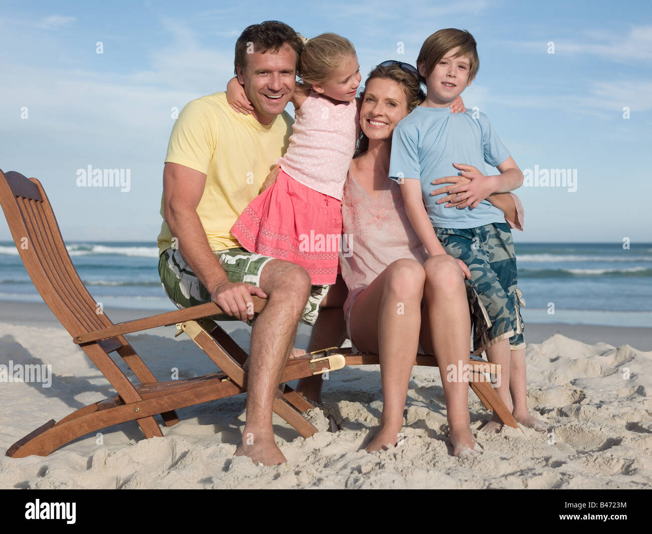 Family on a lounge chair Stock Photo